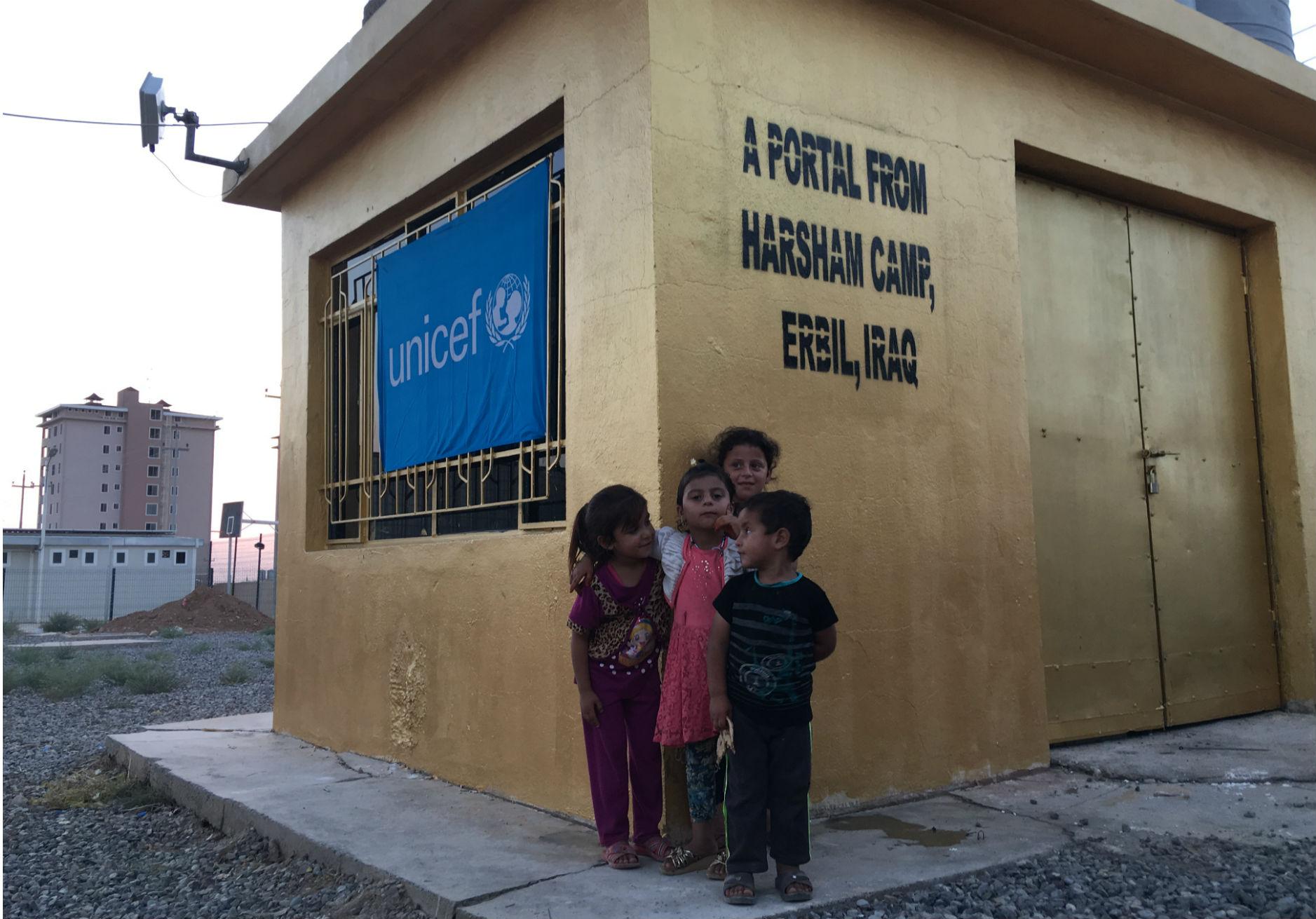 A group of children outside a building