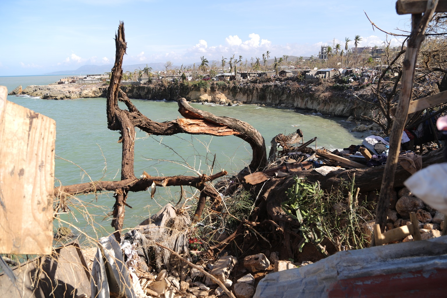 A view of destroyed buildings at water's edge.