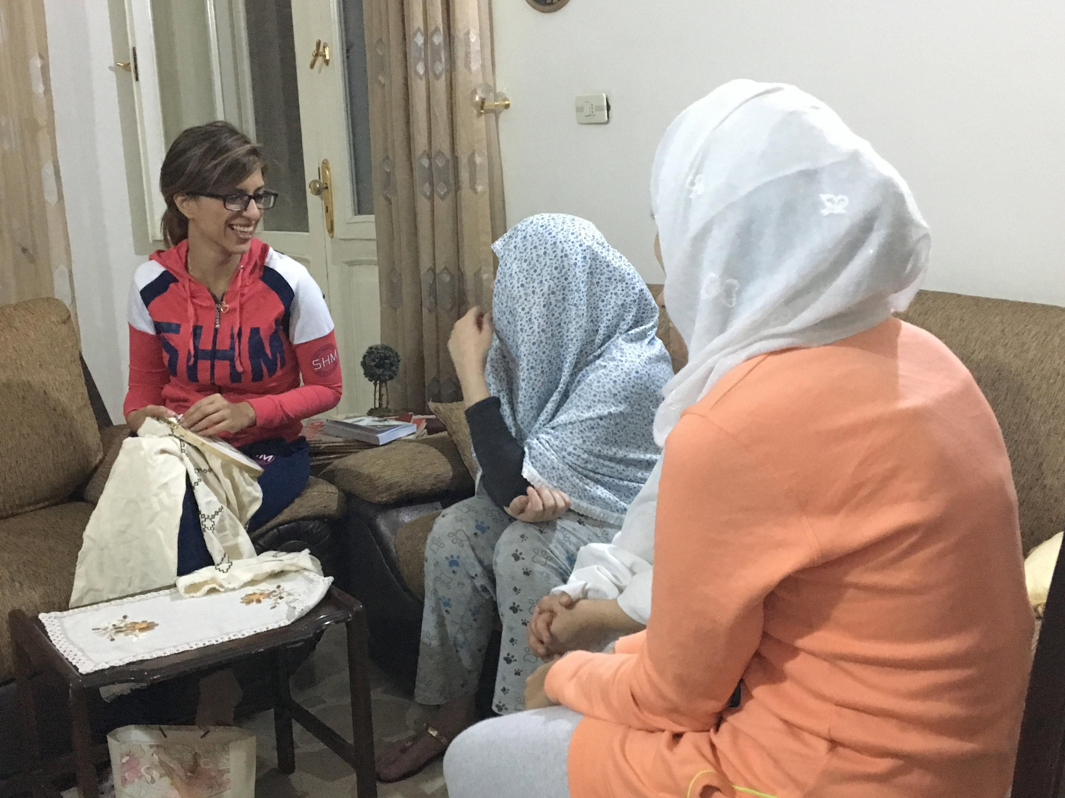 A group of women sitting and talking.