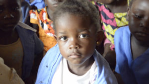 Closeup of small child looking at the camera