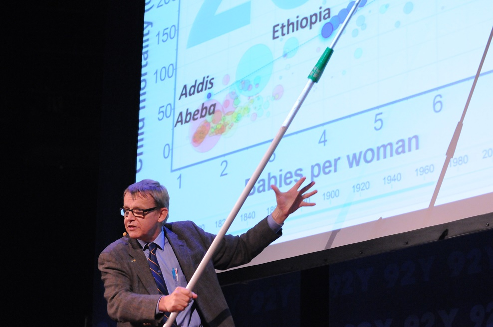 A man using a pointer to point at a chart