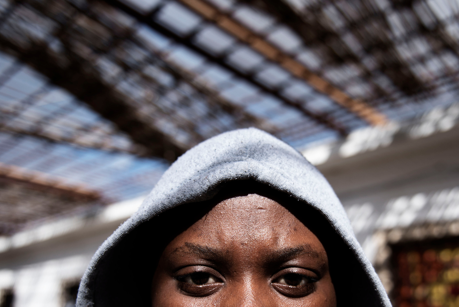 Pati*, 16, a migrant from Nigeria, stands in the courtyard at a detention centre.