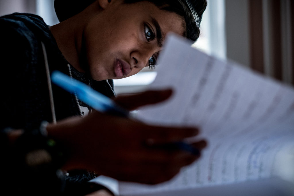 Zein Al-Faraji, 13, does homework at a refugee camp in a geriatriezentrum, a former old persons home, in Vienna's 13th district, in Austria, on September 17, 2016. Zein has been enrolled in a non-integrated school with other refugees learning German for the past six months. The family fled Basra, the southern Iraqi port city, in late 2015 and travelled through the Balkans to Vienna, Austria, to find safety and be able to provide opportunities to Sajad, Zein and Houda that would not have been available at home.
