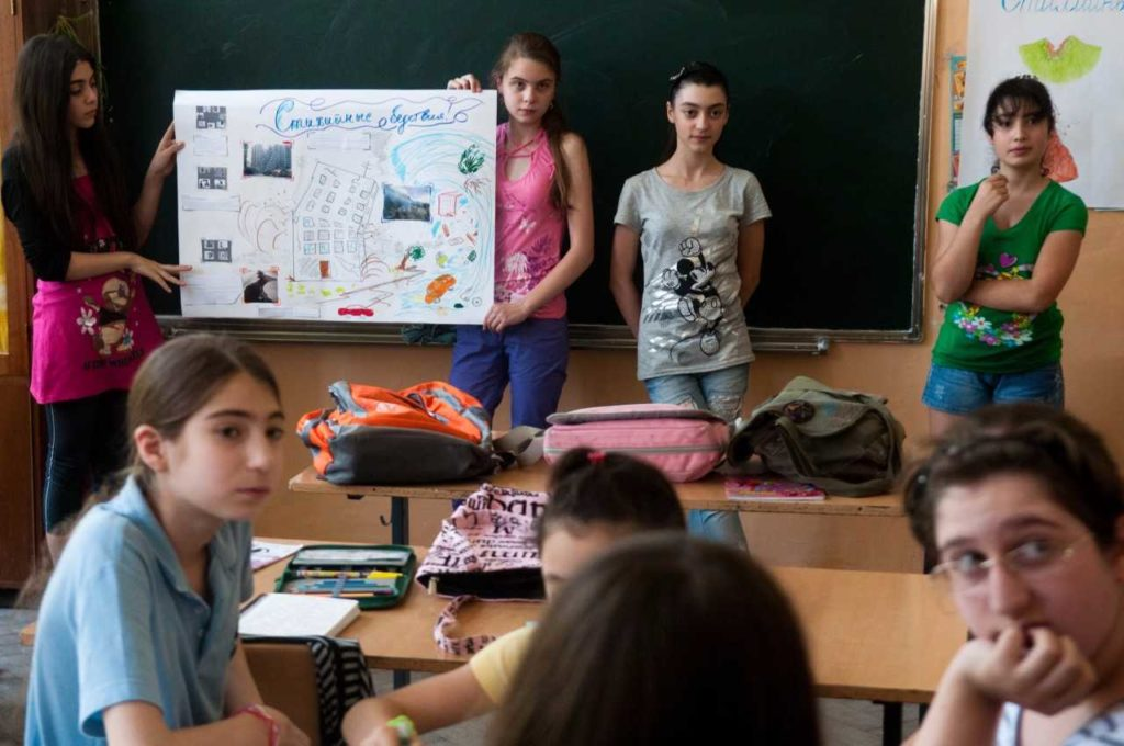 Girls presenting in their classroom