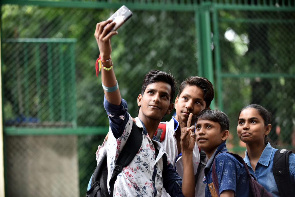Children taking selfies with a mobile phone