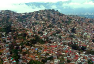 Aerial view of shanties on a hill