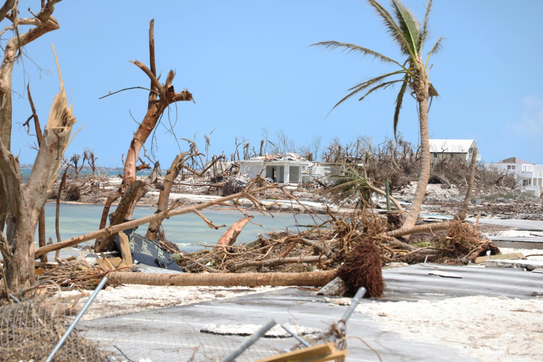 A long view of debris and houses on an island.