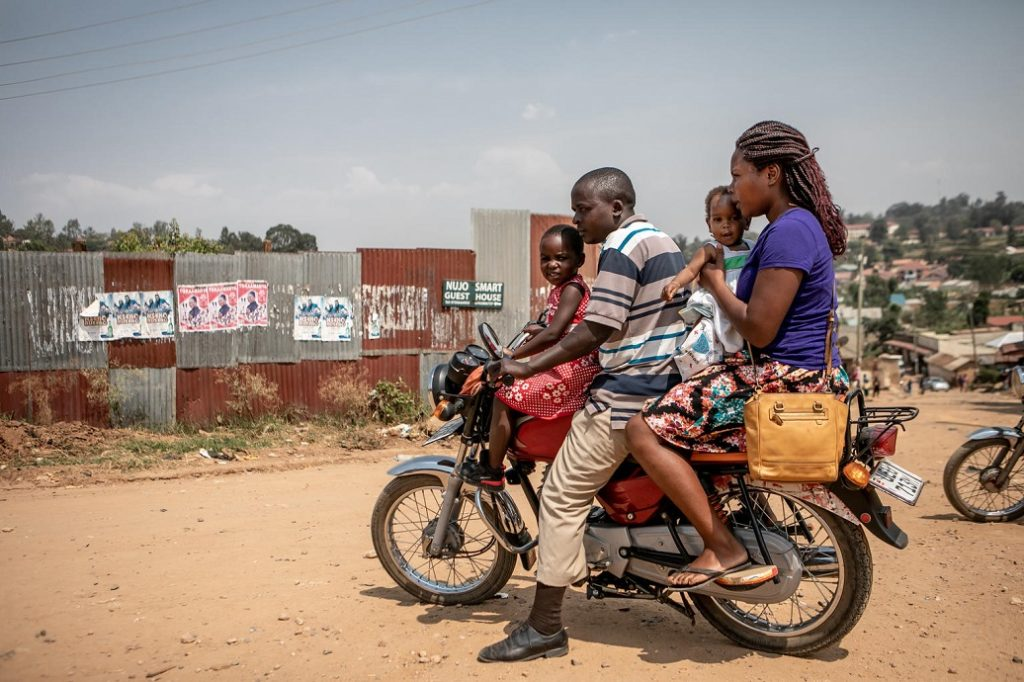 A man, woman and two kids on a motorbike.