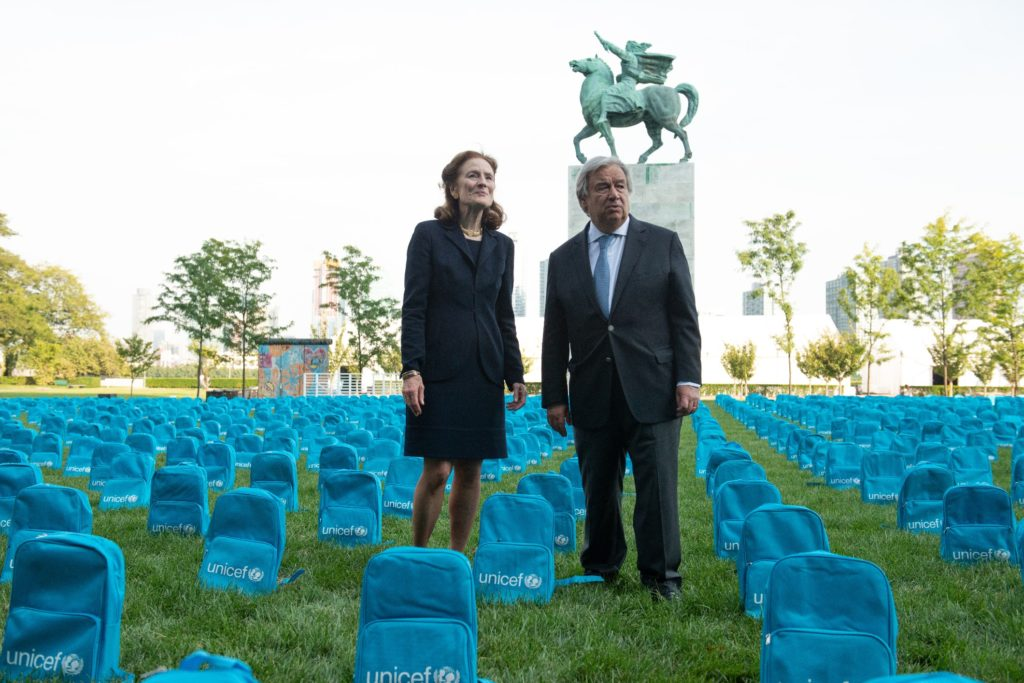 United Nations Secretary-General António Guterres stands with ED Fore in a sea of UNICEF backpacks.