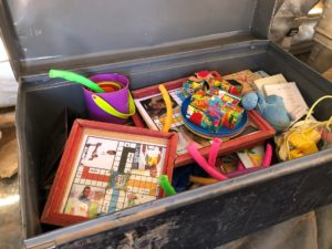 A trunk of educational games and toys provided by UNICEF.
