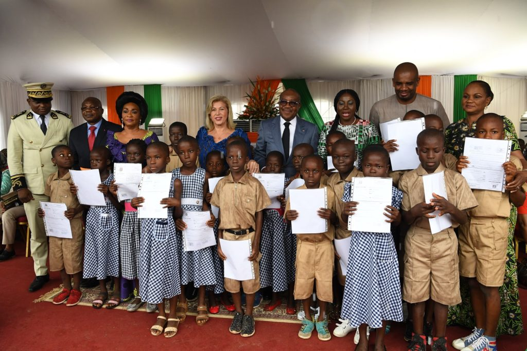 A group photo of children holding up certificates