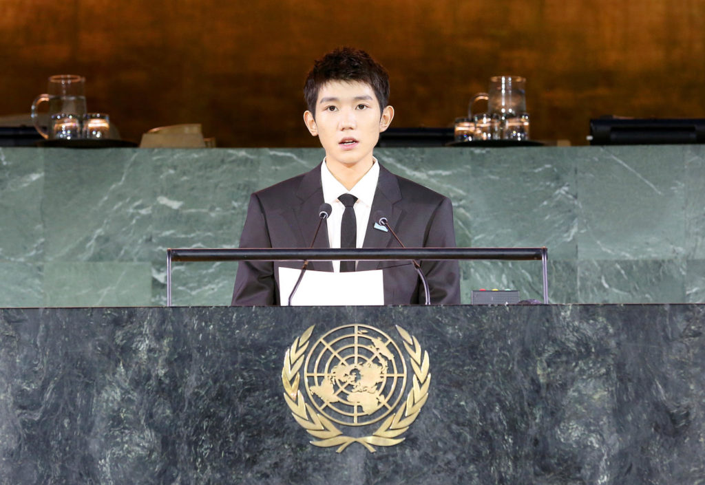 A young man standing at the Main UN Assembly lectern