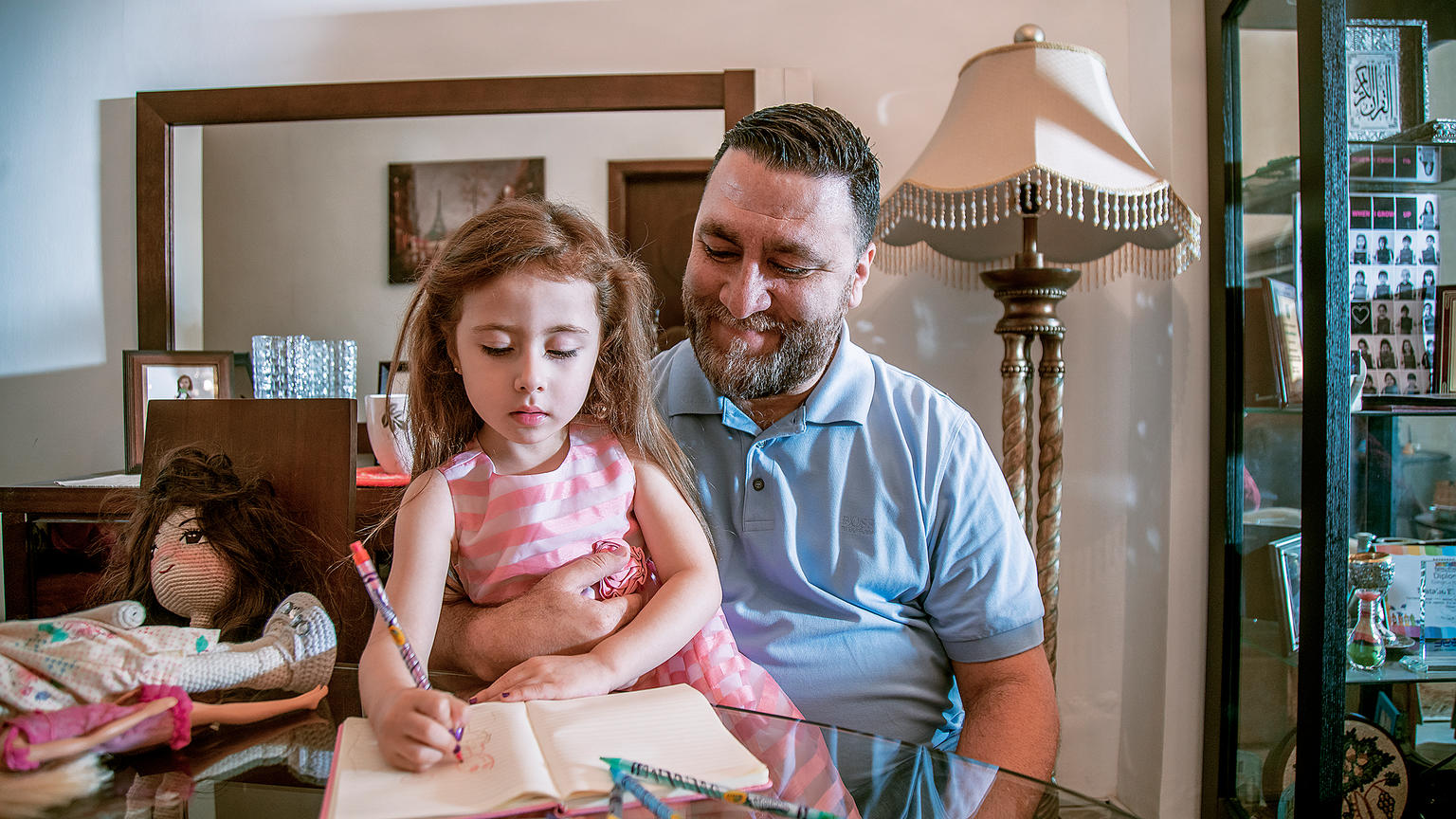 A caregiver father and his daughter at home