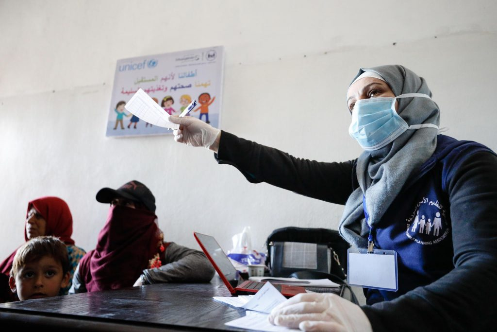 A nurse wearing a clinical mask at a health facility.