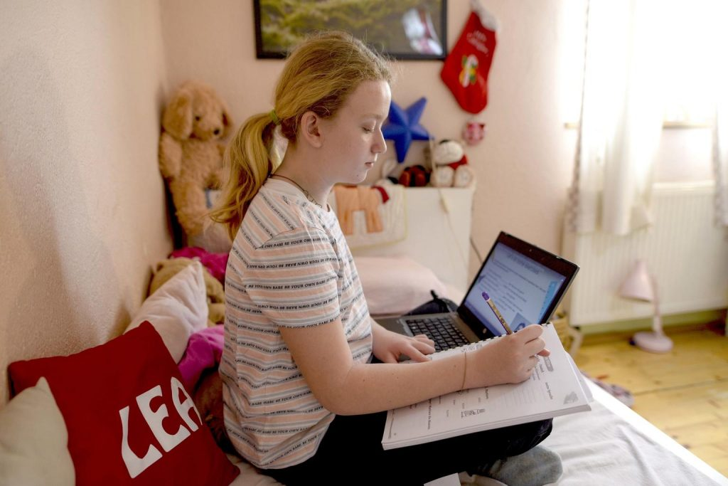 A girl with a laptop at home