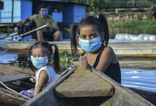 Two young girls in facemasks