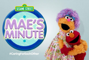 Sesame Street's Mae and Elmo hugging