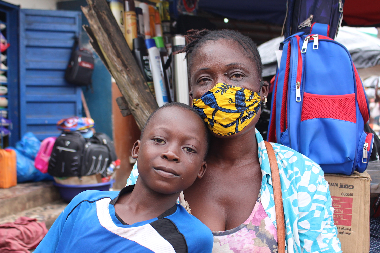 A woman and her son in a marketplace in Sierra Leone